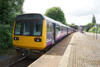 A Colne to Blackpool South service calls at Mill Hill on 03 June 2017. Although the train has 4 carriages (a Class 150 and 142) the rear unit is locked out of service as far as Preston due to platform length at some stations on the line.<br><br>[John McIntyre&nbsp;03/06/2017]
