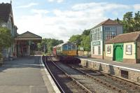 "On 4th July 2017, the last train of the day (the 17.38 service from Wareham to Swanage) enters Corfe Castle station. The token exchange is taking place and the locomotive is Class 33 D6515. Once a ruin like the adjacent castle, this restored station is a glowing testament to enthusiasts who are determined not to sit back and let ""history take its course"".   <br><br>[Mark Dufton&nbsp;04/07/2017]"