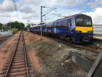 ScotRail 320411 rests in bay platform 1 at Airdrie on 2 August 2017, after treating me to my first 'station skipping' experience. It left on time on its return journey, depositing several bemused 'scenic route' passengers at various stations on the way back west.<br><br>[Colin McDonald&nbsp;02/08/2017]
