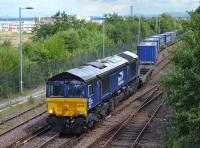 DRS 66432 leaves Fouldubs sidings with the 4A13 Grangemouth - Aberdeen intermodal service.  1 August.<br><br>[Bill Roberton&nbsp;01/08/2017]