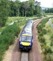 ScotRail 170409 passing Arniston and about to enter the Gore Glen on 30 July 2017. The train is the Sunday morning 0911 Edinburgh - Tweedbank.<br><br>[John Furnevel&nbsp;30/07/2017]