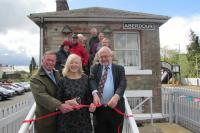 The official re-opening of the former Aberdour signal box in April 2017. Lynette Gray (centre) stands with Colin Whyte (left), ScotRail Alliance commercial property manager, and John Yellowlees (right), honorary ScotRail Alliance community ambassador.<br><br>[ScotRail 25/04/2017]