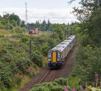380 105 passes the sidings at Hunterston High Level with a train for Largs.<br><br>[Ewan Crawford&nbsp;03/08/2017]