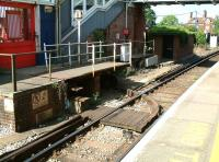 The arrangement at the double-island platform station at Brockenhurst, Hampshire, in 2002, where a rotating turntable bridge was employed to provide step free access (on request) between the station entrance and platforms 1 & 2. (Step free access to platforms 3 & 4 was across the trackbed.) The arrangement came to an end in 2014 when the station received a new footbridge with integral lifts. [See image 47749]<br><br>[Ian Dinmore&nbsp;26/07/2002]