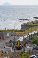 380111 crosses Princes Street to enter Ardrossan Town with a Glasgow bound train. Ailsa Craig is on the horizon.<br><br>[Ewan Crawford&nbsp;10/08/2017]
