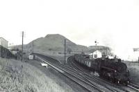 Standard Mogul 76097 runs through Annbank Junction with a coal train in May 1962 on its way from Polquhairn to Ayr.  <br><br>[G H Robin collection by courtesy of the Mitchell Library, Glasgow&nbsp;24/05/1962]
