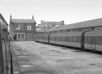 Ardrossan Town with a class 107 in the bay platform. This photograph was taken in 1985, the station had closed in 1965 and would re-open in 1987. Two sidings, one alongside the platform, remained in the bay for stabling in 1985.<br><br>[Bill Roberton&nbsp;//1985]
