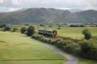 ATW 158818, on a short working from the junction to Llandudno, runs by a local golf course with the Conwy Estuary in the background on 26th July 2017.<br><br>[Mark Bartlett&nbsp;26/07/2017]