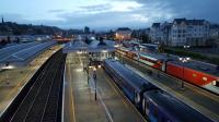 First light on a damp morning at Stirling and the red and grey livery of the 0526 VTEC service to Kings Cross contrasts with the blue of the Scotrail Sprinter in the bay platform. 7th August 2017.<br> <br><br>[David Prescott&nbsp;07/08/2017]