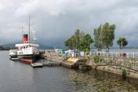 Paddle Steamer <I>Maid of the Loch</I>, still berthed alongside Balloch Pier in August 2017and acting as a cafe while awaiting operational restoration. The station finally closed in 1986 but the line of the old platform, minus its canopy, is shown by the white railings. <br><br>[Mark Bartlett&nbsp;01/08/2017]