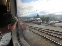 An interested passenger looks out at an Andalsnes train at Dombass.<br><br>[John Yellowlees&nbsp;18/07/2017]