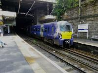 A Helensburgh train pulls into Charing Cross on 5 August. Being substantially underground with trains coming to stop in the gloom at either end, this is a challenging location to photograph!<br><br>[David Panton&nbsp;05/08/2017]