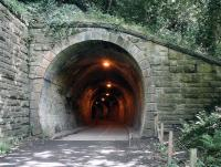 The south western portal of Colinton Tunnel on the Balerno branch. Photographed on 27 July 2017 from the site of Colinton station. The tunnel, which is on a contnuous south west to north curve throughout its 153 yard length, now forms part of the Water of Leith walkway. For a view of the north portal [see image 60150].    <br><br>[John Furnevel&nbsp;27/07/2017]