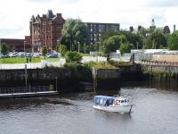The modern day Govan Ferry, as seen from the <I>Glenlee</I> tall ship at the Riverside Museum of Transport in July 2017. The little boat provides a handy free link to the museum from Govan Subway station using the pontoon seen here.  [See image 54433] showing the slipway that used to be used for its larger predecessor. <br><br>[Mark Bartlett&nbsp;31/07/2017]