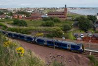 380111 leaving Ardrossan Town, passing the platform extension at the north end. The South Beach (the actual beach, not the station) is seen in the background.<br><br>[Ewan Crawford&nbsp;10/08/2017]