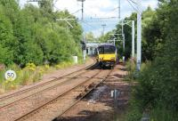 318252 approaching Kirkwood station with a Whifflet to Dalmuir sevice on 28th July 2017. The train has just passed the site of Langloan station which closed in 1964<br><br>[Alastair McLellan&nbsp;28/07/2017]