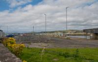 Looking over the site of Winton Pier station towards the buffers. The wall in the foreground was the wall on the west side of the station, now the back wall of the covered walking way from Ardrossan Harbour to the CalMac terminal.<br><br>[Ewan Crawford&nbsp;10/08/2017]