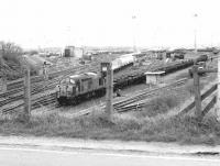 View south over Millerhill yard in the spring of 1980, with EE Type 3 37083 ready to leave with a freight.<br><br>[John Furnevel&nbsp;22/04/1980]