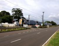 A Dunbar service crosses St Germains level Crossing in the East Lothian countryside on 16th August 2017. The ScotRail services from Waverley to Dunbar call only at Musselburgh leaving the other stations to their hourly North Berwick<br> trains. The reason for this is not obvious to me. It's surely not a path<br> issue?<br> <br><br>[David Panton&nbsp;16/08/2017]