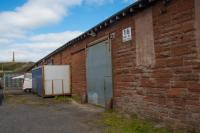 The reverse (non station) side of the former goods shed at Ardrossan Town, now given over to other uses. In the background on Castlehill is the MacFadzean Memorial.<br><br>[Ewan Crawford&nbsp;10/08/2017]