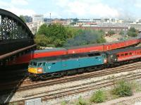 A Virgin Cross Country service about to pass below Bath Road bridge shortly after leaving Bristol Temple Meads on 2 August 2002. The train is hauled by XP64-liveried Brush Type 4 D1733/47853 <I>Rail Express</I>.<br><br>[Ian Dinmore&nbsp;02/08/2002]