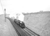 Stanier Black 5 4-6-0 no 44767 with the much photographed northbound train of diesel shunters over the Waverley route on 11 April 1967, seen here approaching Kelso Junction. This unique locomotive (fitted with Stephenson valve gear) was subsequently preserved [see image 4874] and now carries the name <I>George Stephenson</I>.<br><br>[Bruce McCartney&nbsp;11/04/1967]