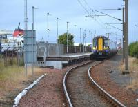 380 111 at Ardrossan Harbour with a service to Glasgow Central, on 14 August.  On the left is the red funnel of MV Caledonian Isles with a Brodick sailing.<br><br>[Bill Roberton&nbsp;14/08/2017]