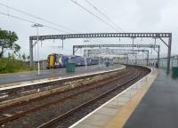 Platform 1 at Gourock is very convenient for ferry passengers but if Platform 3 is in use it is a bit of a trudge. 380108 waits in Platform 3 to form a fast service to Glasgow Central on 31st July 2017. <br><br>[Mark Bartlett&nbsp;31/07/2017]