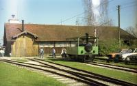 A steam outline diesel tram locomotive stands outside the shed and workshops of the Chiemsee-Bahn at Prien-Stock in Bavaria. The photo was taken in April 1989 and at the time, the station of this short narrow gauge line was to the left. It is understood that the shed in this photo was demolished in 2011 and replaced with a new building and station. The station is next to a pier for ferries sailing on Chiemsee, including to Herreninsel and island where the palace of Herrenchiemsee is situated. The palace was built for King Ludwig II of Bavaria and is based upon the palace of Versailles.<br><br>[John McIntyre&nbsp;/04/1989]