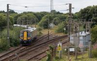 380108 takes the Ardrossan Harbour line at Holm Junction. Ahead is the turnback siding and to the right the Largs branch.<br><br>[Ewan Crawford&nbsp;10/08/2017]