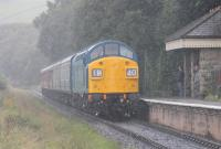 In a sudden downpour, that thankfully was quickly over, 40135 approaches Irwell Vale halt with a five coach train for Rawtenstall on 19th August 2017. The steam heat fitted Class 40 has been based on the East Lancashire Railway since 1988 and recently underwent a body overhaul and repaint into BR Blue. <br><br>[Mark Bartlett&nbsp;19/08/2017]