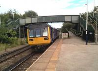 The 18.09 to Sheffield leans into the curve as it stops at Conisbrough, four stops from its destination. The Pacers may be old and basic, but they are still providing a useful service.<br><br>[Ken Strachan&nbsp;16/08/2017]