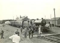 Snappers leaving a special at Tarbolton to find a good vantage point during a photostop on 9 May 1959. The train is the SLS <i>Land o' Burns</i> railtour from Ayr, hauled by 2P 4-4-0 40574, which also visited Catrine and Muirkirk. <br><br>[G H Robin collection by courtesy of the Mitchell Library, Glasgow&nbsp;09/05/1959]