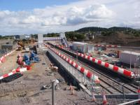 A view of the re-sited Forres station nearing completion taken from the new overbridge built to replace the Waterford Road level crossing on the east side of the station. View taken during an organised visit to the site.<br><br>[Douglas Blades&nbsp;29/08/2017]