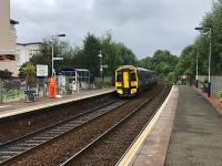 The 0939 Anniesland service departs from the very well tended Summerston station at the end of August 2017. A fine selection of plants adorns the platforms.<br><br>[Colin McDonald&nbsp;29/08/2017]