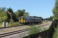 Two Class 153 single units form a Preston to Blackpool North service seen approaching Poulton station on 26th August 2017. The semaphore on the down line is in its last year of operation and a new AWS ramp can be seen on the Up line although masts have not been erected at this location yet.<br><br>[Mark Bartlett&nbsp;26/08/2017]