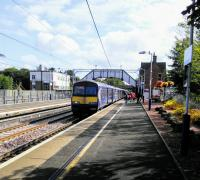 A Lanark to Glasgow Central service calls at a well-kept Uddingston on 2nd<br> September 2017. Having been brought up in Duddingston I've always felt that<br> Uddingston has something lacking.<br> <br><br>[David Panton&nbsp;02/09/2017]