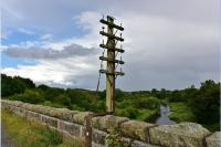 The viaduct at Ellon over the River Ythan has a telegraph pole still in situ on the east parapet with a support forged from a rail.<br><br>[John Gray&nbsp;23/08/2017]