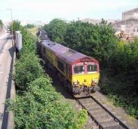 EWS 66205 moving away from Seafield level crossing on 7 June 2006 with a trainload of imported coal from Leith Docks. The contents are destined for Cockenzie power station. <br><br>[John Furnevel&nbsp;07/06/2006]