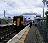 A Falkirk Grahamston to Glasgow Queen Street service calls at Gartcosh on 2nd<br> September 2017. These services will be electrified in due course, to join the<br> half-hourly Cumbernauld to Dumbarton services which also call here.<br> <br><br>[David Panton&nbsp;02/09/2017]
