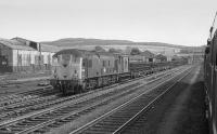 24009 with a train of bullhead track panels in the loops to the south of Perth.  Seen from the 'Strathmore Express', returning from Forfar on 25 May 1974. Former railway works are seen in the background.<br><br>[Bill Roberton&nbsp;25/05/1974]