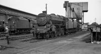 Fifty years ago today; having secured permission to go round Carlisle Kingmoor, this was the melancholy sight which greeted my father and myself as we made our way towards the shed building on 27th August 1967 - Black 5 No. 45120 which had been withdrawn two months previously, with classmate No. 44928 to its left, also a June 1967 casualty. Behind 45120 is a withdrawn 9F, possibly No. 92080 which had succumbed in May.<br> While the peripheral sidings were full of withdrawn locos, a fair proportion of the 105 locos seen were still active, including two Holbeck Jubilees (45562 and 45593) which had arrived in Carlisle the previous day on dated SO workings over the S&C. In fact it was difficult to believe that 12A was due to close just four months later. I wonder who the young chap on the left is - probably he's now one of these grey haired old geysers still to be seen at Citadel station whenever steam is due on a special!<br><br>[Bill Jamieson&nbsp;27/08/1967]