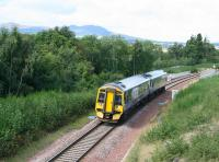 ScotRail 158715 forming the 1154 Edinburgh – Tweedbank on 6 September 2017, seen here shortly after crossing the Gore Glen bridge over the A7.<br><br>[John Furnevel&nbsp;06/09/2017]