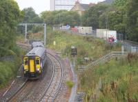 Seen shortly after leaving platform 3 at Anniesland, 156495 forms the 1156 Queen Street via Maryhill service. In the left background strengthening works are in progress on the Strathcona Drive bridge over the main Northbank electric lines.<br><br>[Colin McDonald&nbsp;20/09/2017]