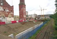 Progress at Shrubhill on 19 September 2017, looking south east towards Leith Walk. Further demolition has taken place and major new construction is apparent in the background beyond the cranes. Parts of the old tram depot scheduled for preservation stand in the left foreground, including the unique octagonal works chimney. The rusting Powderhall branch runs off to the right.<br><br>[Andy Furnevel&nbsp;19/09/2017]