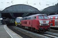DB freight diesel No. 225 012 pauses on the westbound centre road at Aachen Hbf with a double deck EMU of Type VIRM on its delivery run from the Talbot works in Aachen to Nederlandse Spoorwegen (Dutch Railways).<br><br>[Bill Jamieson&nbsp;26/08/2002]