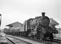 Ivatt 2MT 2-6-0 46430 shunting mixed goods wagons alongside the small goods shed at Garstang Town station. This loco was new to Preston shed in December 1948 but later went to Stoke-on-Trent so this image will probably be from the early 1950s. <br><br>[Knott End Collection&nbsp;//]
