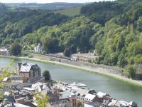 SNCB electric locomotive 1355 takes a lengthy freight northwards along the valley of the River Meuse approaching Dinant on 6th September 2017. This view taken from the ramparts of the Citadel that sits high above the town and is accessed by cable car. <br><br>[Mark Bartlett&nbsp;06/09/2017]