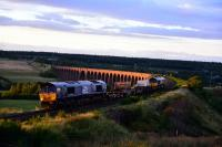 The Late evening sun lights up 66302 and 66301 *Kingmoor TMD* as they<br> leave Inverness for Carlisle with the Flask special. 66301 has taken over<br> the name * Kingmoor TMD * from 37688 which has entered preservation at the<br> Mid Norfolk Railway.<br><br>[John Gray&nbsp;//2017]
