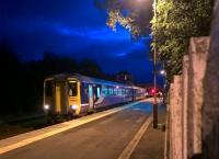 The 22.00 to Newcastle-upon-Tyne pauses at Haltwhistle on 2nd August. The light in the signal box is deceptive - it is no longer in use. <br><br>[Ken Strachan&nbsp;02/08/2017]